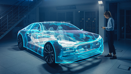 Female Automotive Engineer Uses Digital Tablet with Augmented Reality for Car Design Editing and Improvement. 3D Graphics Visualization Shows Fully Developed Vehicle Prototype Analysed and Optimized