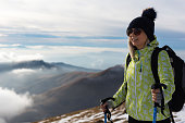 Female backpacker enjoys in view on the mountain