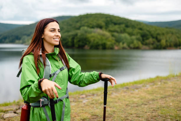Female backpacker exploring majestic nature on her own stock photo