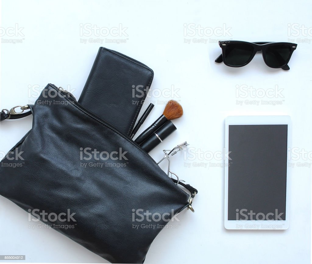 Female bag with cosmetics, sunglasses and tablet stock photo