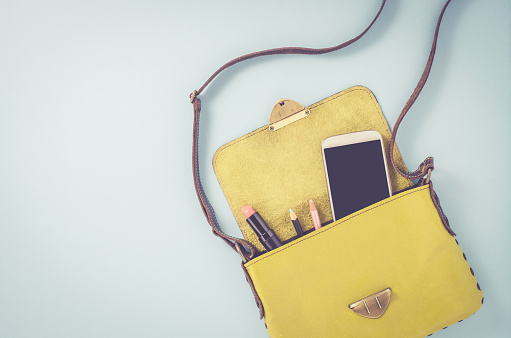istock Female bag with smart phone and cosmetics 819259970