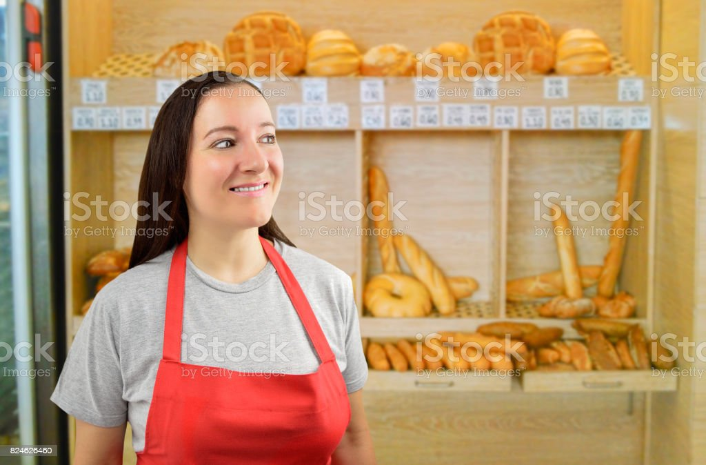 female baker looking askance stock photo