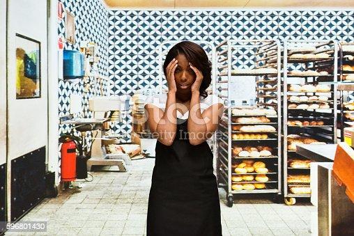 545282128 istock photo Female baker looking sad in bakery 596801430