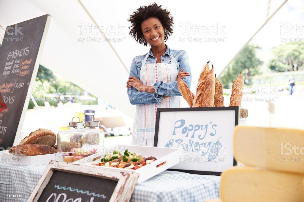 Female Bakery Stall Holder At Farmers Fresh Food Market stock photo