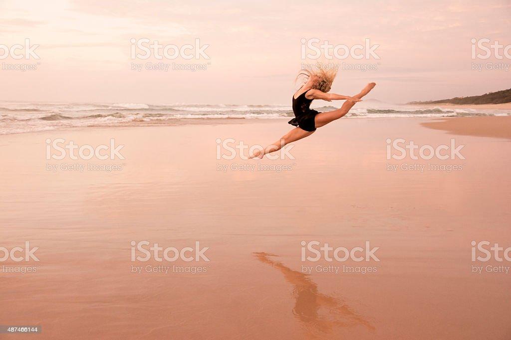Female Ballet dancer dancing on beach stock photo
