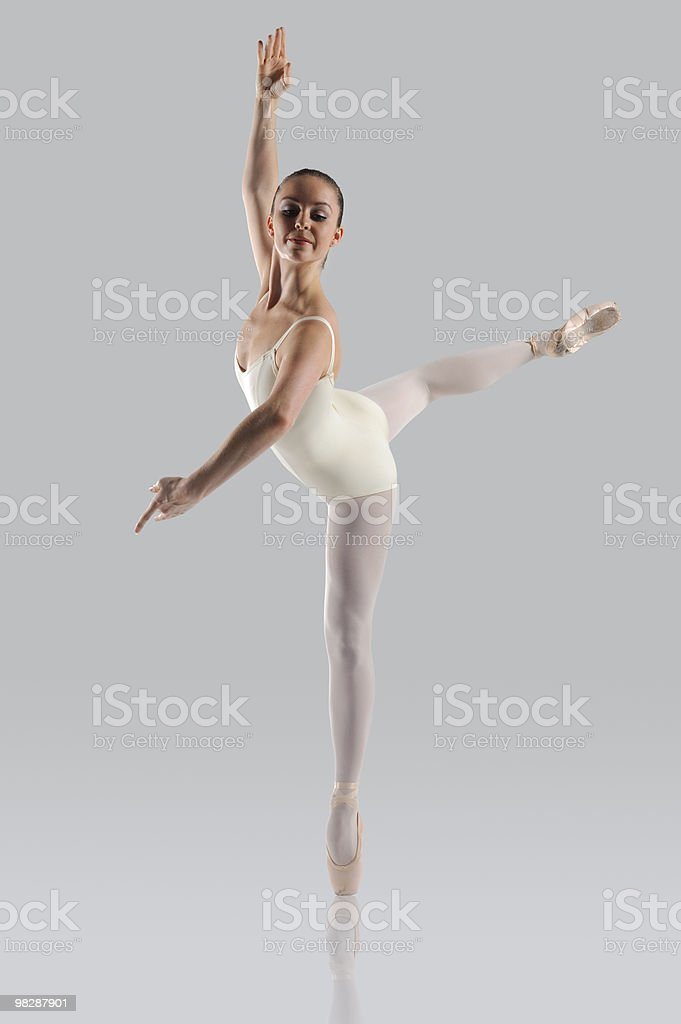 Female ballet dancer on a gray background royalty-free stock photo