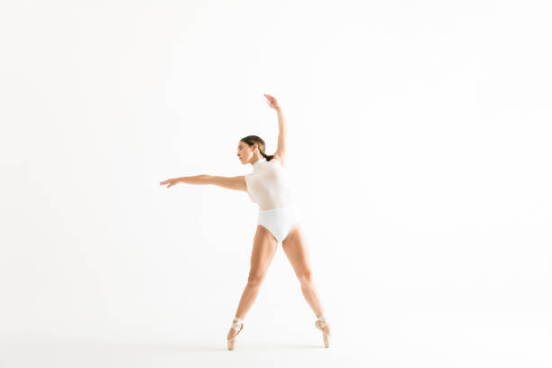 female ballet dancer wearing leotard while dancing with grace - leotard stock pictures, royalty-free photos & images