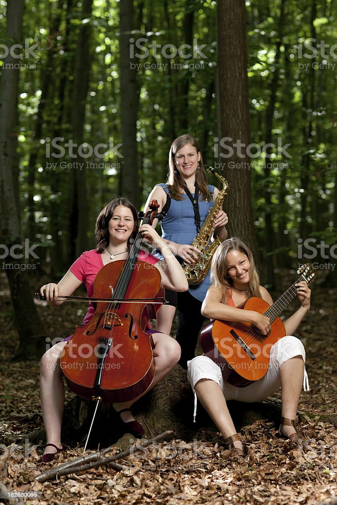 female band in forest royalty-free stock photo