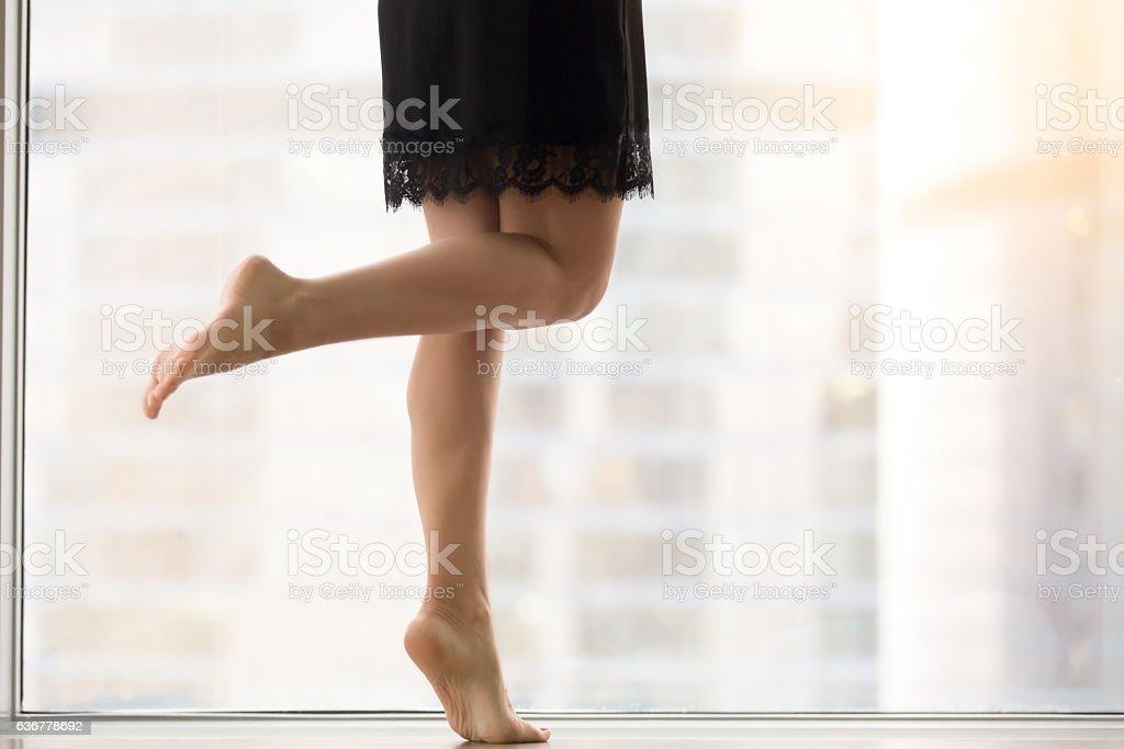 Female bare legs stock photo