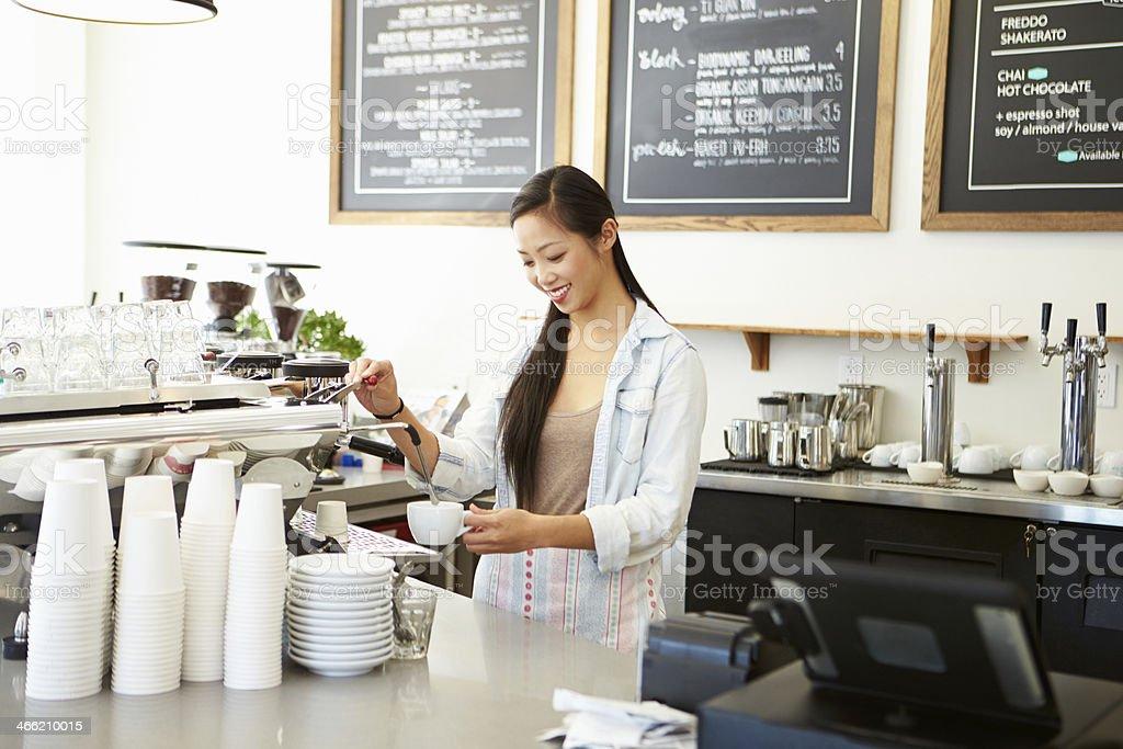 Female barista in a coffee shop stock photo