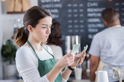 Female Barista Is Disappointed With Her Tips Stock Photo - Download Image Now