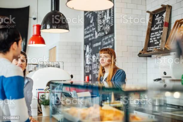 Female barista looking at customers in coffee shop picture id701038542?b=1&k=6&m=701038542&s=612x612&h=cwnvhiyasgqbc7ccptkeaertp3u66uf7olfsaazxzv4=