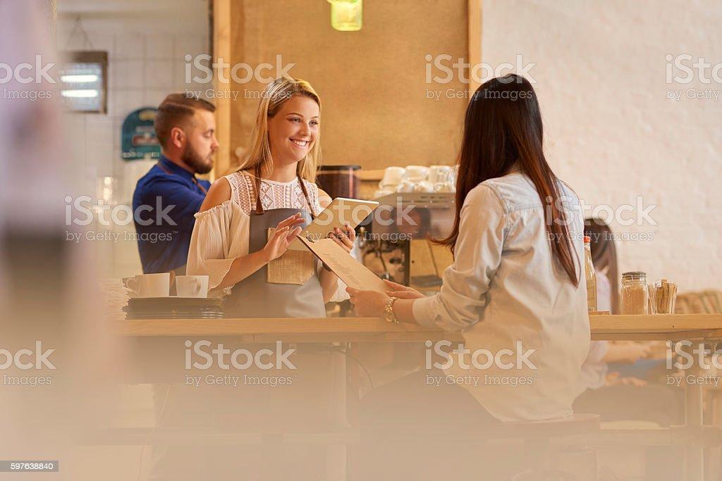 female barista taking order stock photo