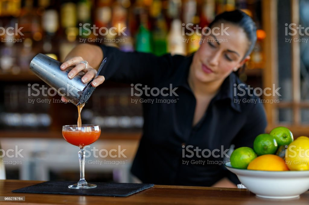 Female Bartender Making Cocktails royalty-free stock photo