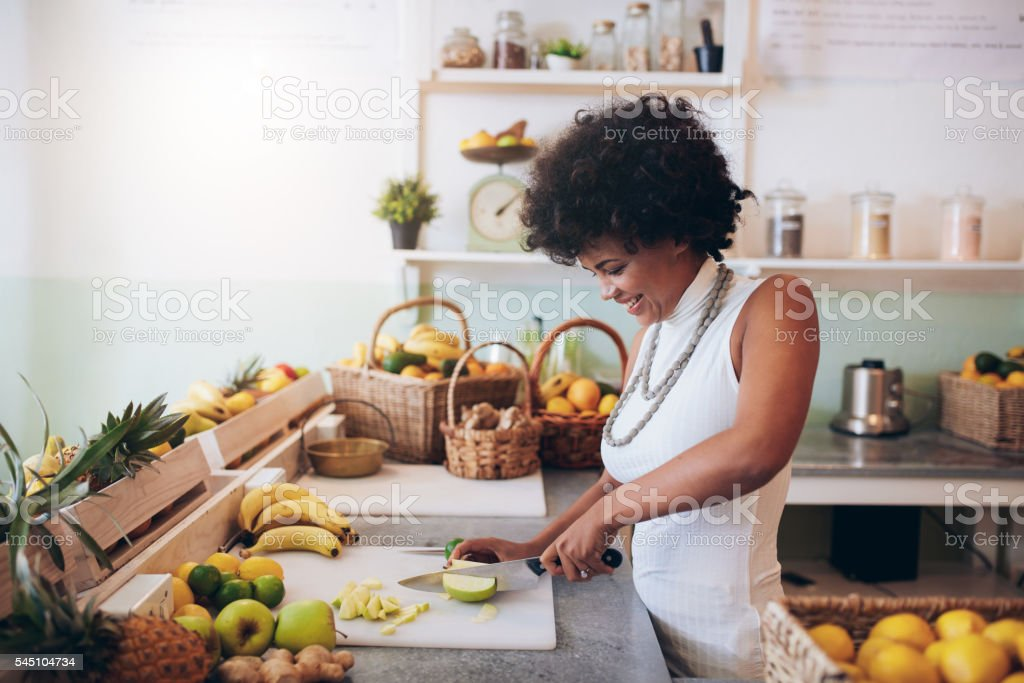 Female bartender making fresh juice stock photo