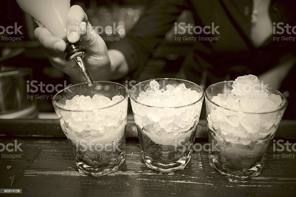 Female bartender pouring juice in glass, retro style royalty-free stock photo