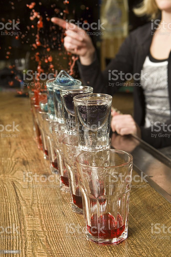 Female Bartender Releasing a little Flair royalty-free stock photo
