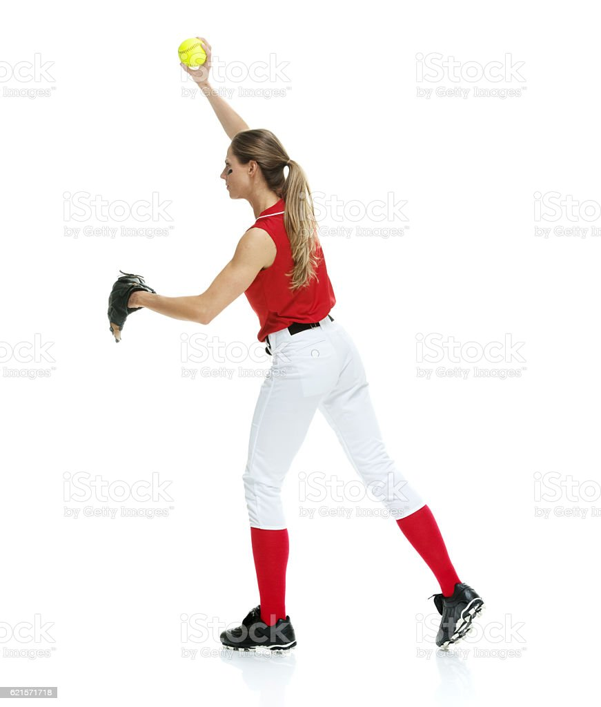 Female baseball player throwing stock photo