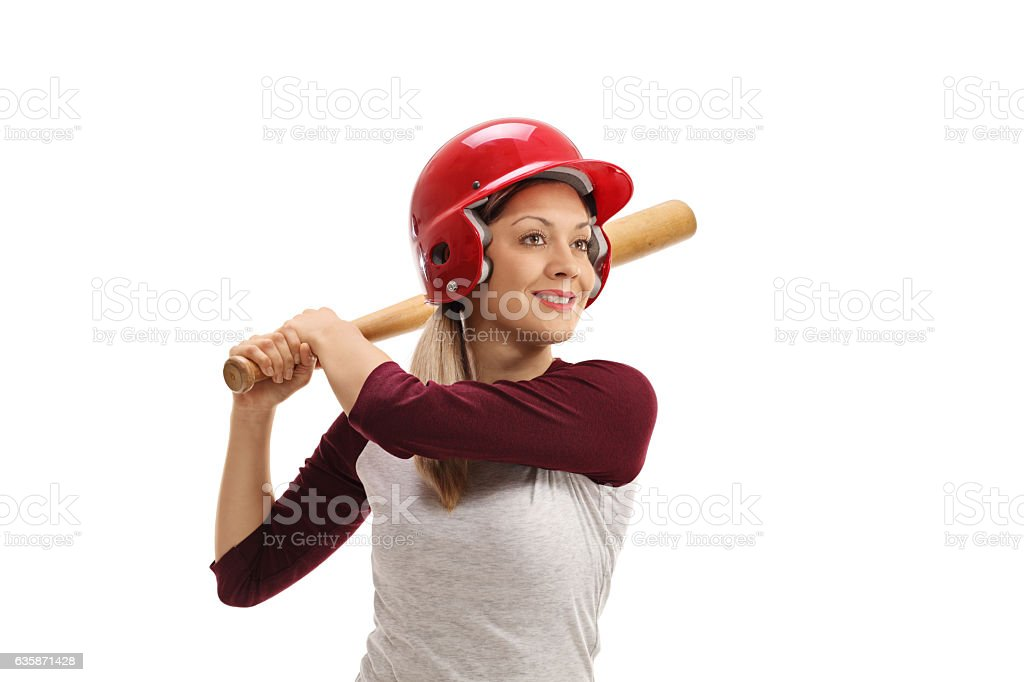 Female baseball player with a wooden bat ready to strike stock photo