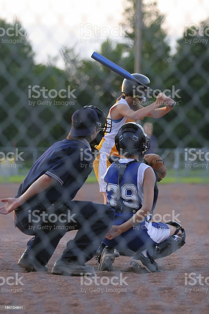 Female Baseball players with referee royalty-free stock photo