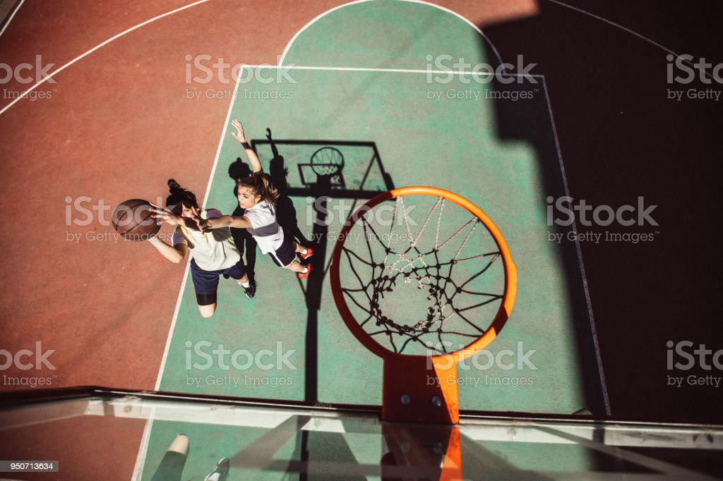 Female basketball outdoors stock photo