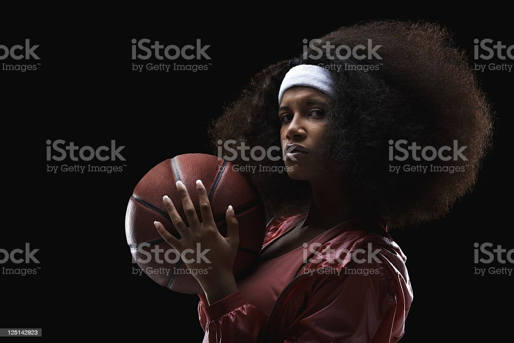 Female basketball player on black background royalty-free stock photo