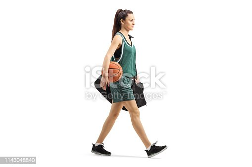 istock Female basketball player walking with a sports bag 1143048840