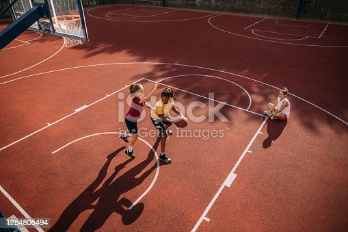 Skilled female basketball players enjoying a game together on a sunny and warm day in Serbia