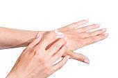 Female beautiful delicate manicured hands with moisturizing cream