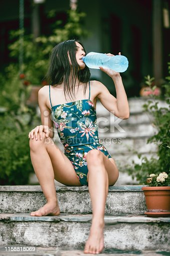 Female Beauty Drinking Water During A Hot Day