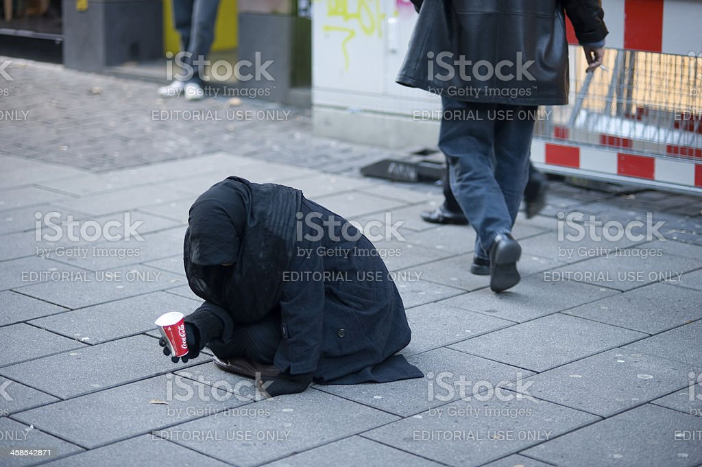 Female Beggar stock photo