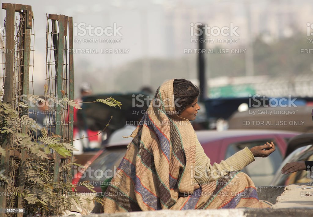 female begger at street of noida new delhi india stock photo