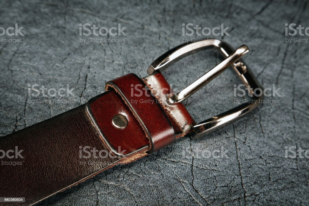 Female belt against from a  leather grey foto stock royalty-free
