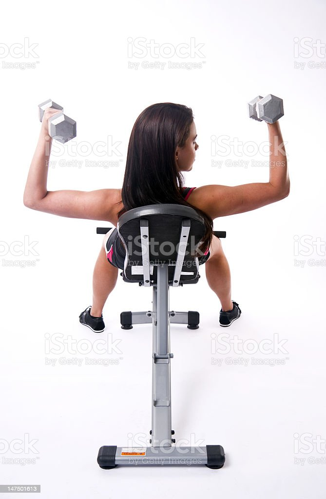 Female Bench Committed Physical Fitness Curling Weights Working Out royalty-free stock photo