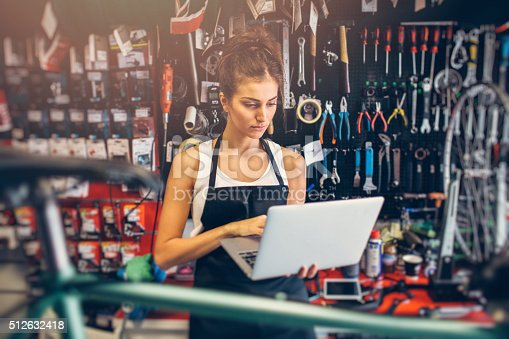 istock Female Bicycle Mechanic 512632418