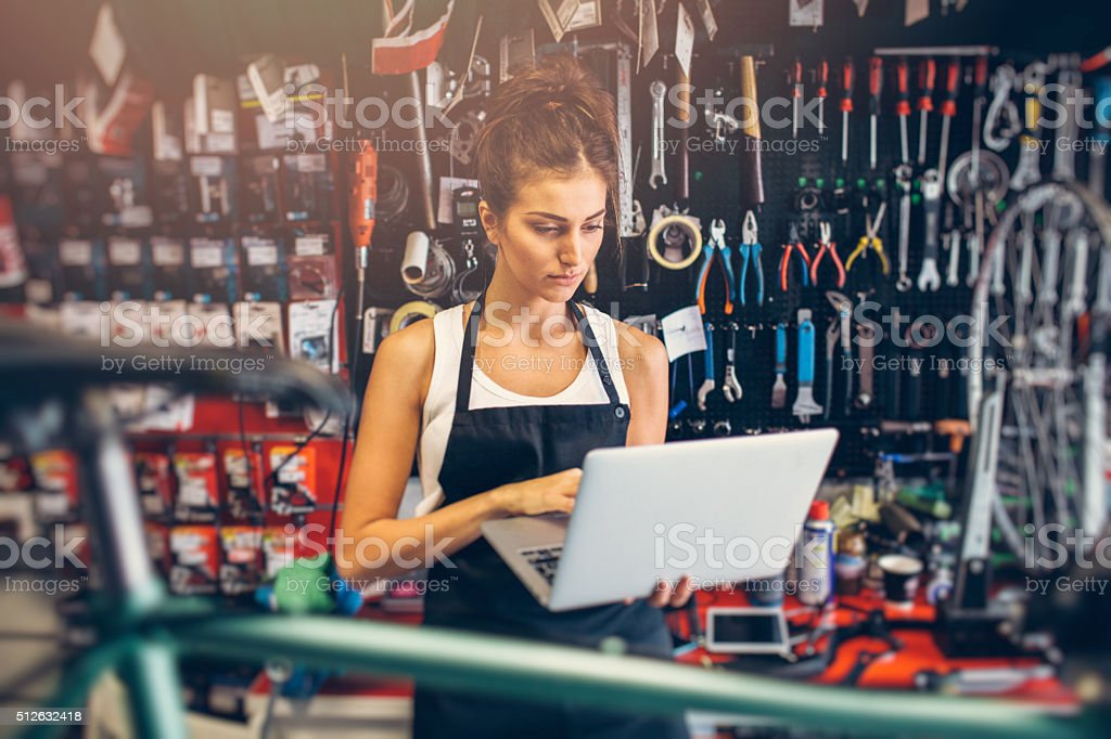 Female Bicycle Mechanic stock photo