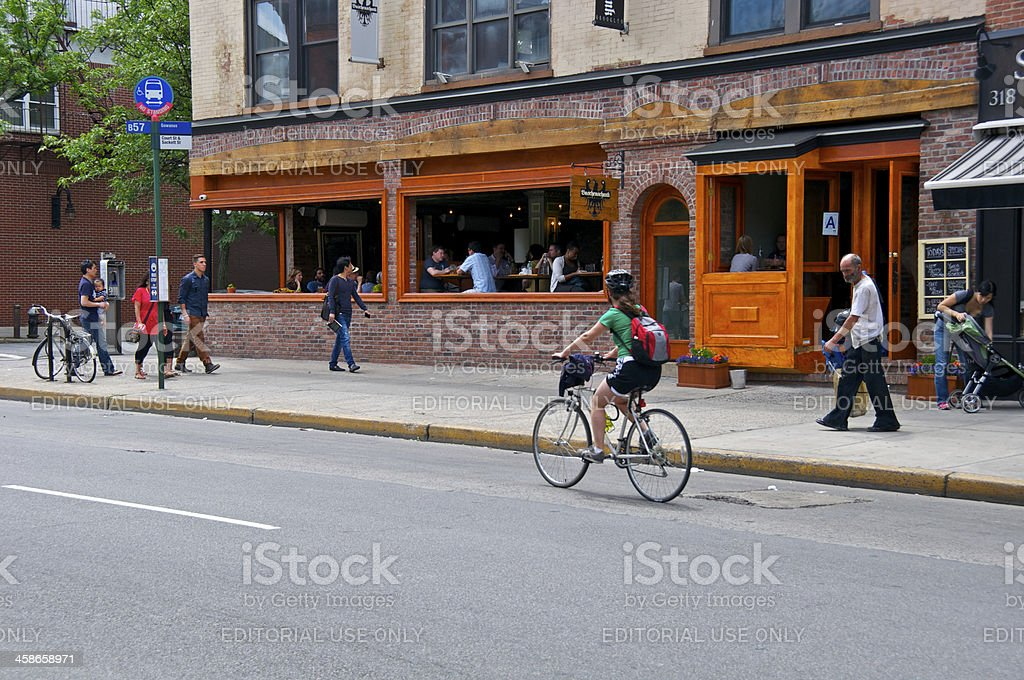 Female Bicyclist in Cobble Hill, Brooklyn, New York City royalty-free stock photo