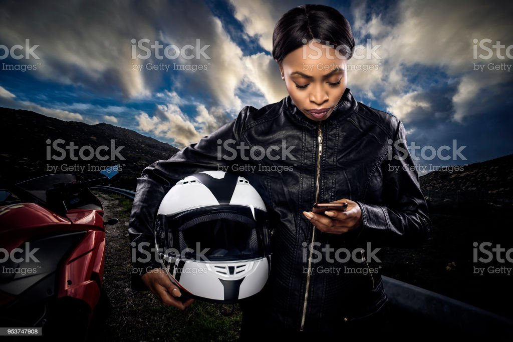 Female Biker Looking at GPS stock photo