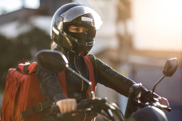 Female biker riding a motorcycle- Motogirl, Motoboy stock photo