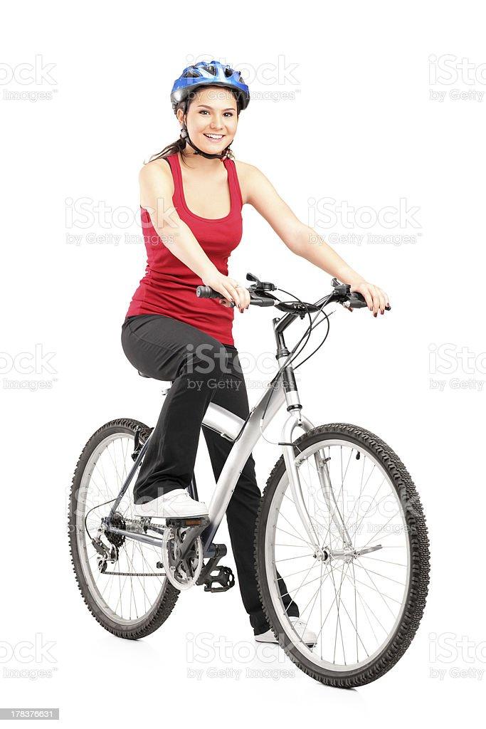 Female biker with helmet posing on a bike royalty-free stock photo