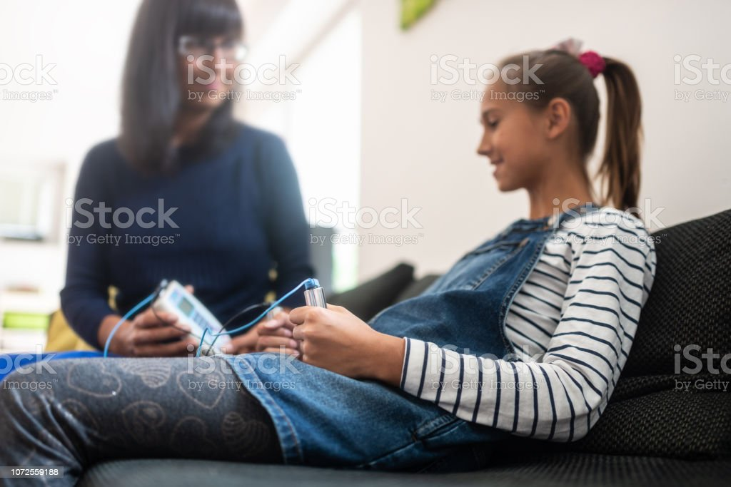 Female bioresonance therapist with her young client stock photo