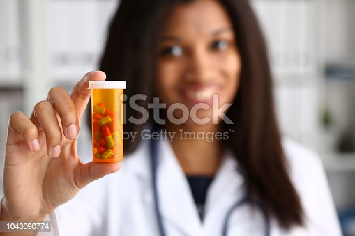 istock Female black doctor hands hold and give 1043090774