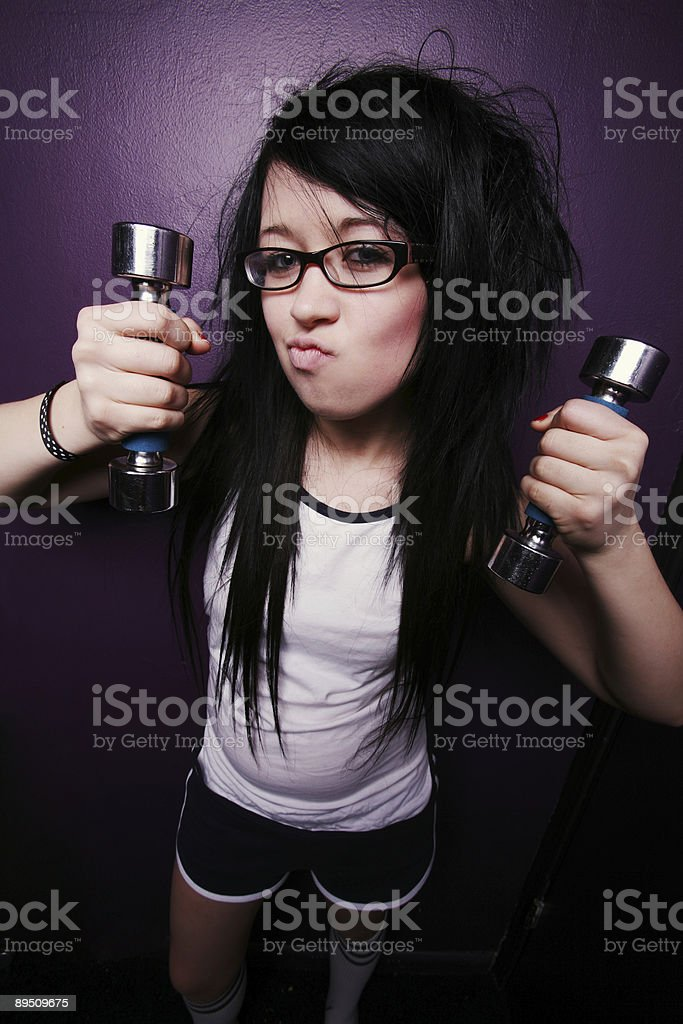 Female Black Hair Girl Pumping Weights royalty-free stock photo