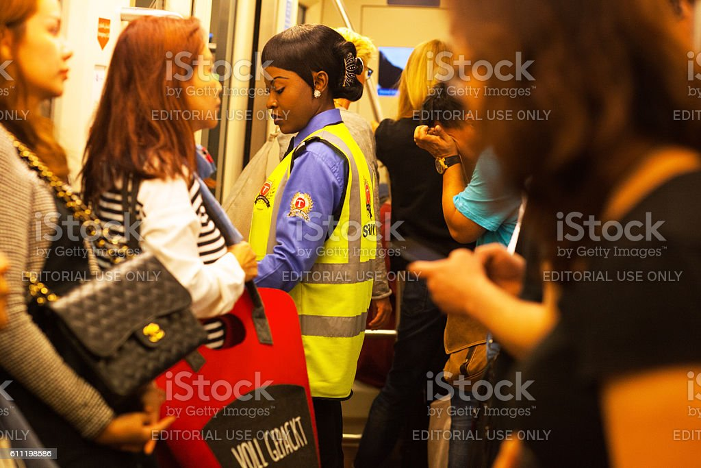 Female black security staff in airport Dubai stock photo