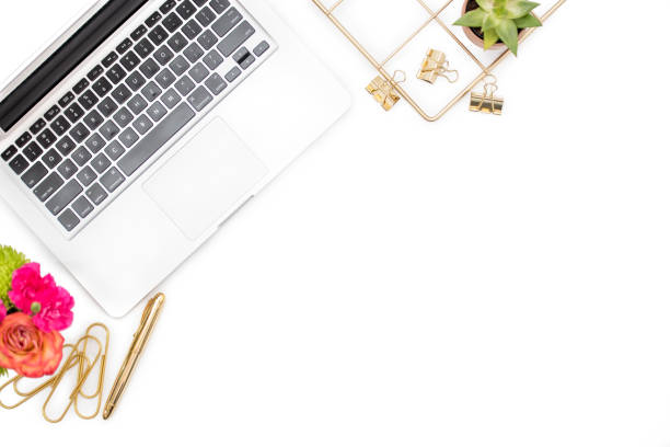 A female bloggers desk from above stock photo