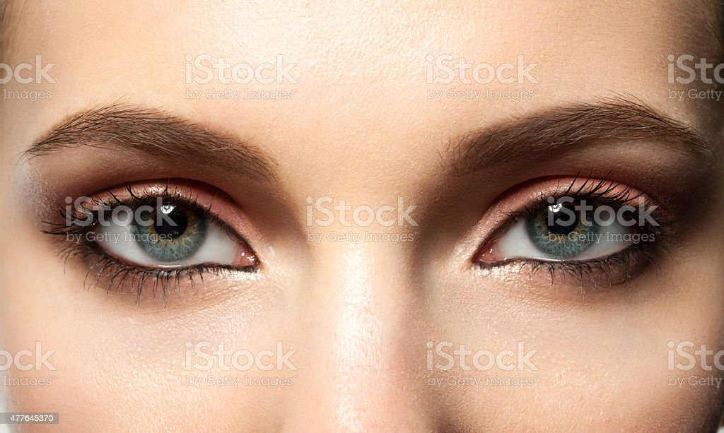female blue eye with makeup stock photo
