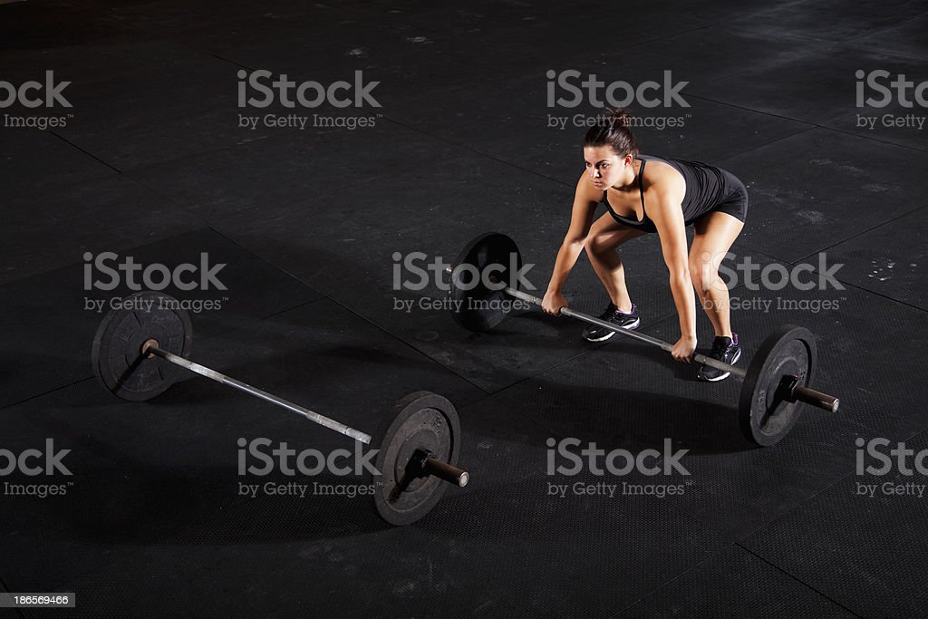 Female body builder lifting barbell stock photo