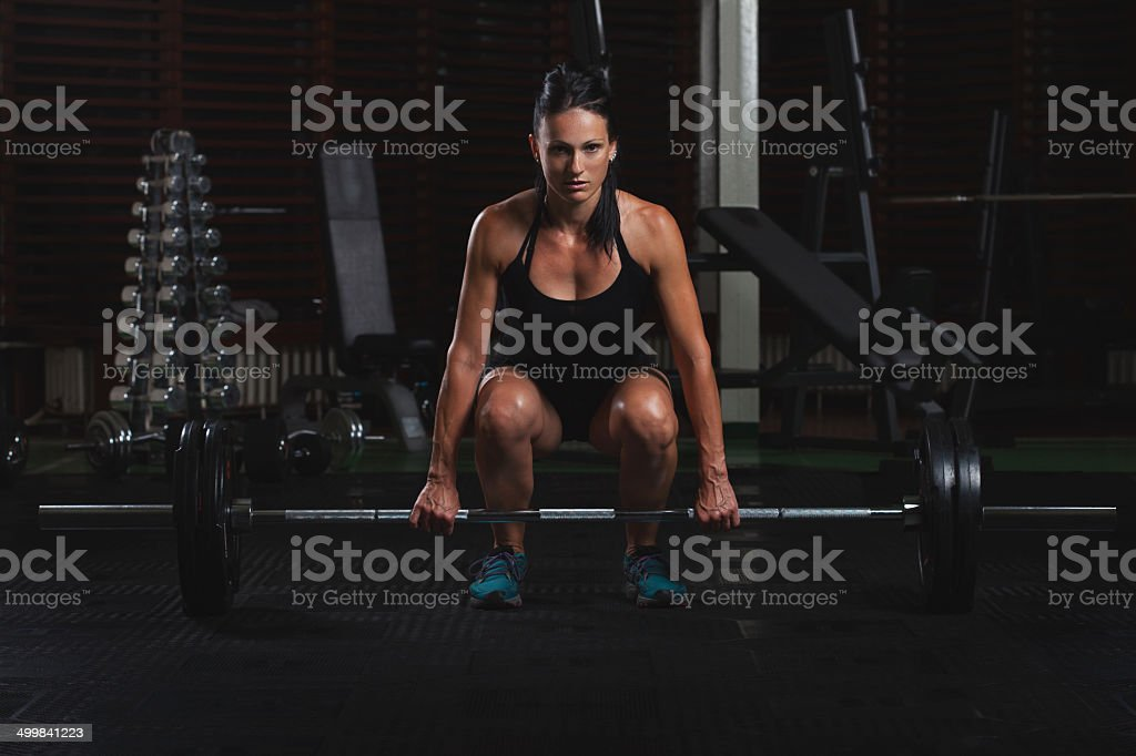 Female Body builder practising in the gym stock photo
