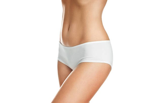 Female body wearing white underwear on white background stock photo