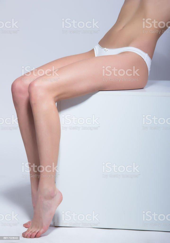 Female body wearing white underwear on white background stock photo